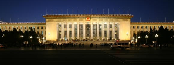 A brightly lit Great Hall of The People at dusk.